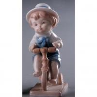 PMF 28959 мальчик на велосипеде 12*4,5*7см